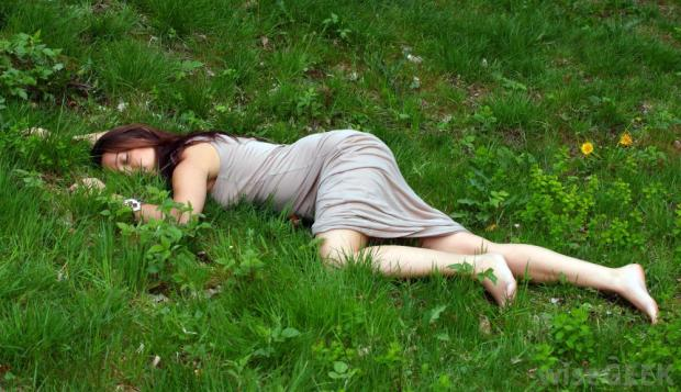 ad5cf-woman-face-down-on-grass